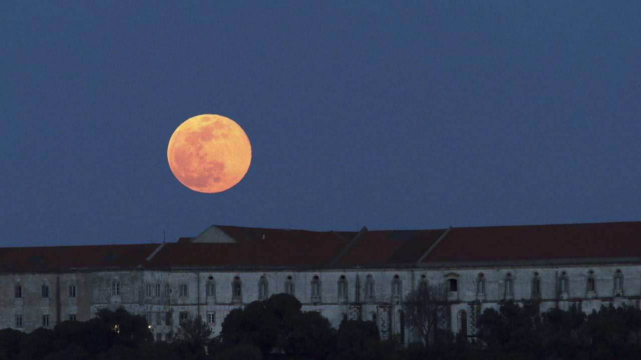 The full moon rises behind the Graca Monastery in Lisbon, on Tuesday, February 19 2019. It is the year's second supermoon, when a full moon appears a little bigger and brighter thanks to its slightly closer position to Earth. Picture: Armando Franca