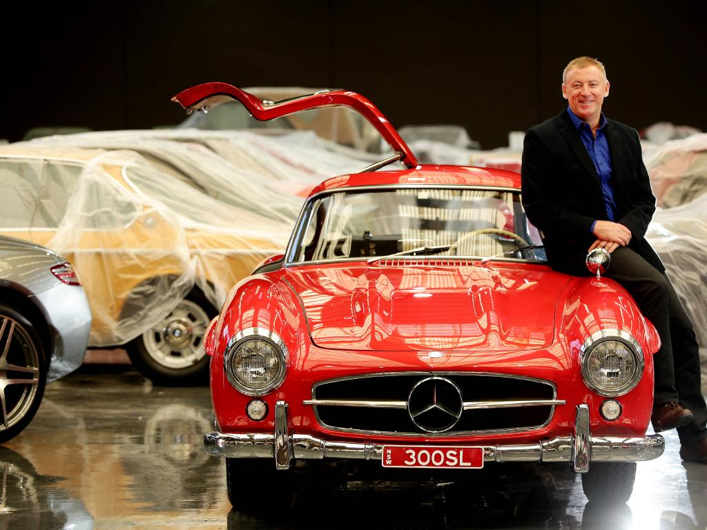 Happier times. Mr Denny pictured with 300SLGullwing 1955 ahead of its grand opening. Photo: Sue Graham
