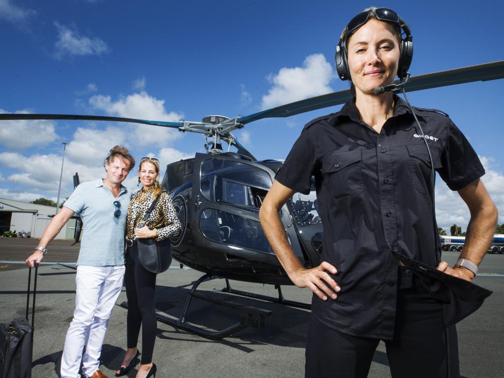 Ghost Air Helicopter pilot Jo Osborne with real estate agents Steve Gage and Francene Storie who will use the service. Picture: Lachie Millard