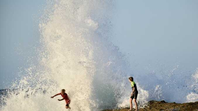 Young swimmers knocked down by swell at Snapper Rocks on the Gold Coast generated by Tropical Cyclone Oma. Picture: Mark Furler