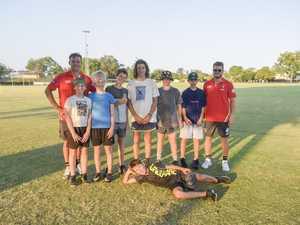 YOUNG GUNS: Sydney Swans players Joel Amartey (far
