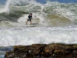 Surfers enjoy the large swell off Mooloolaba Beach