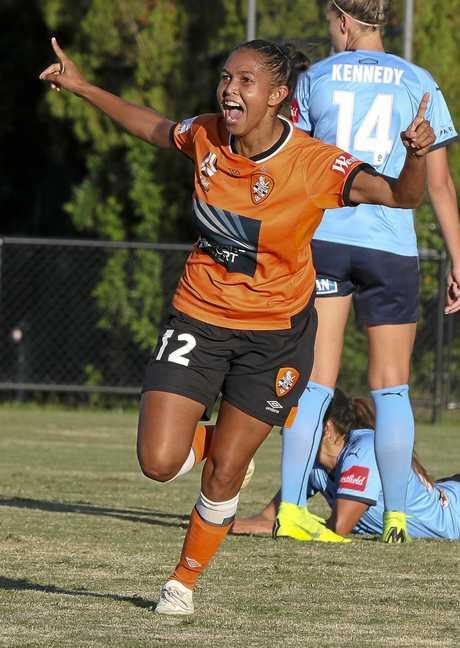 Former Ipswich City bulls and Brisbane Roar player Allira Toby celebrates a W-League goal.
