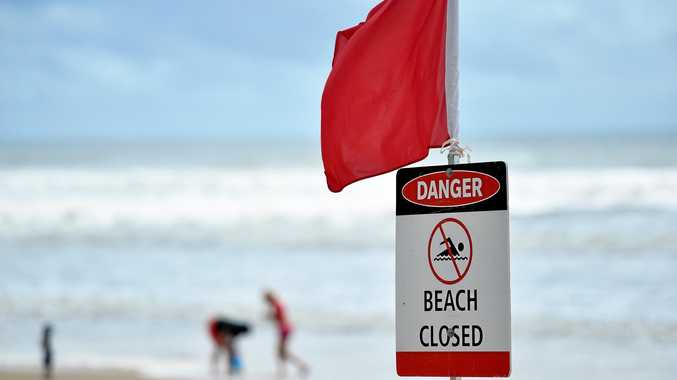 Surf Lifesaving Queensland lifeguards are taking no chances with the predicted wild weather, closing a number of beaches already this morning.