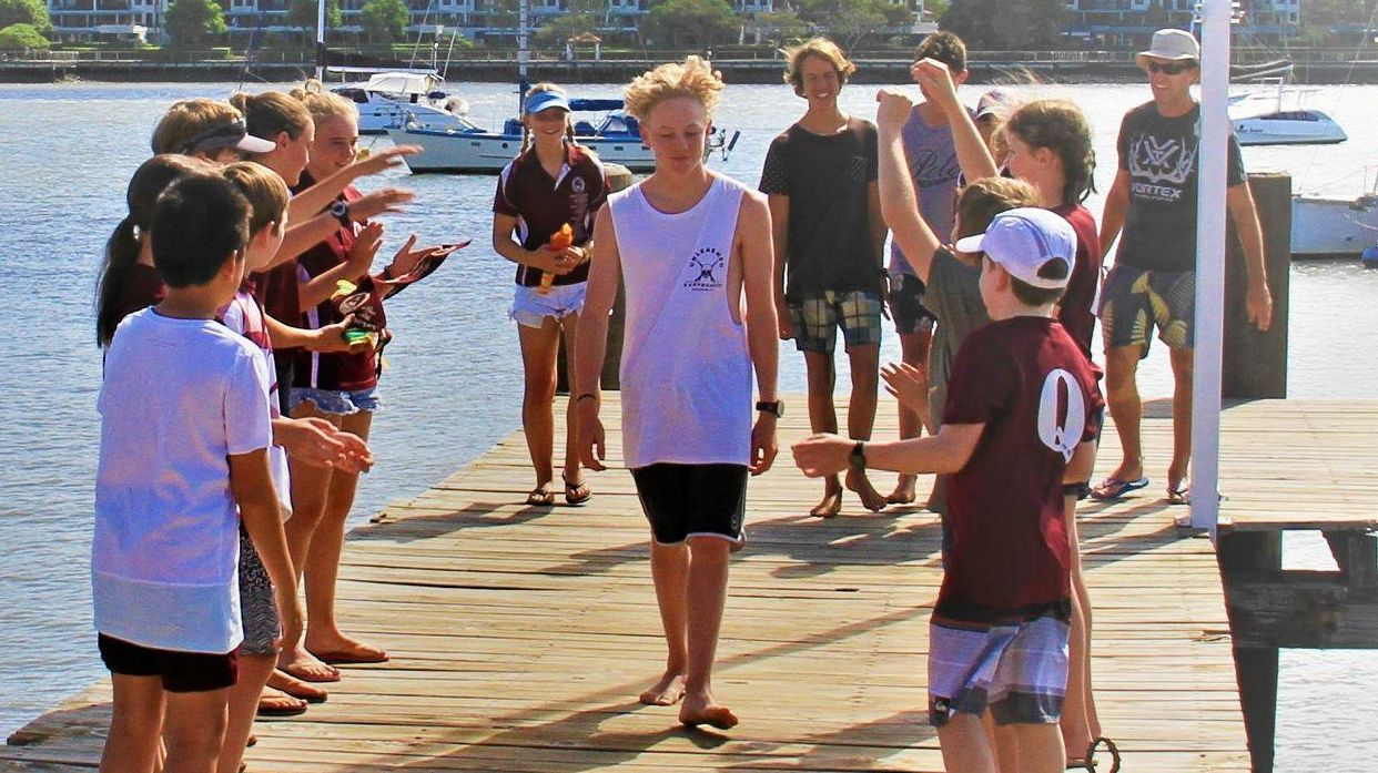 CHAMP: James Beveridge takes the walk of honour at the end of last weekend's South Queensland Sabot Association River Titles.