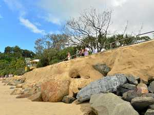 Storm surge strips beach and may flood Noosa's iconic street