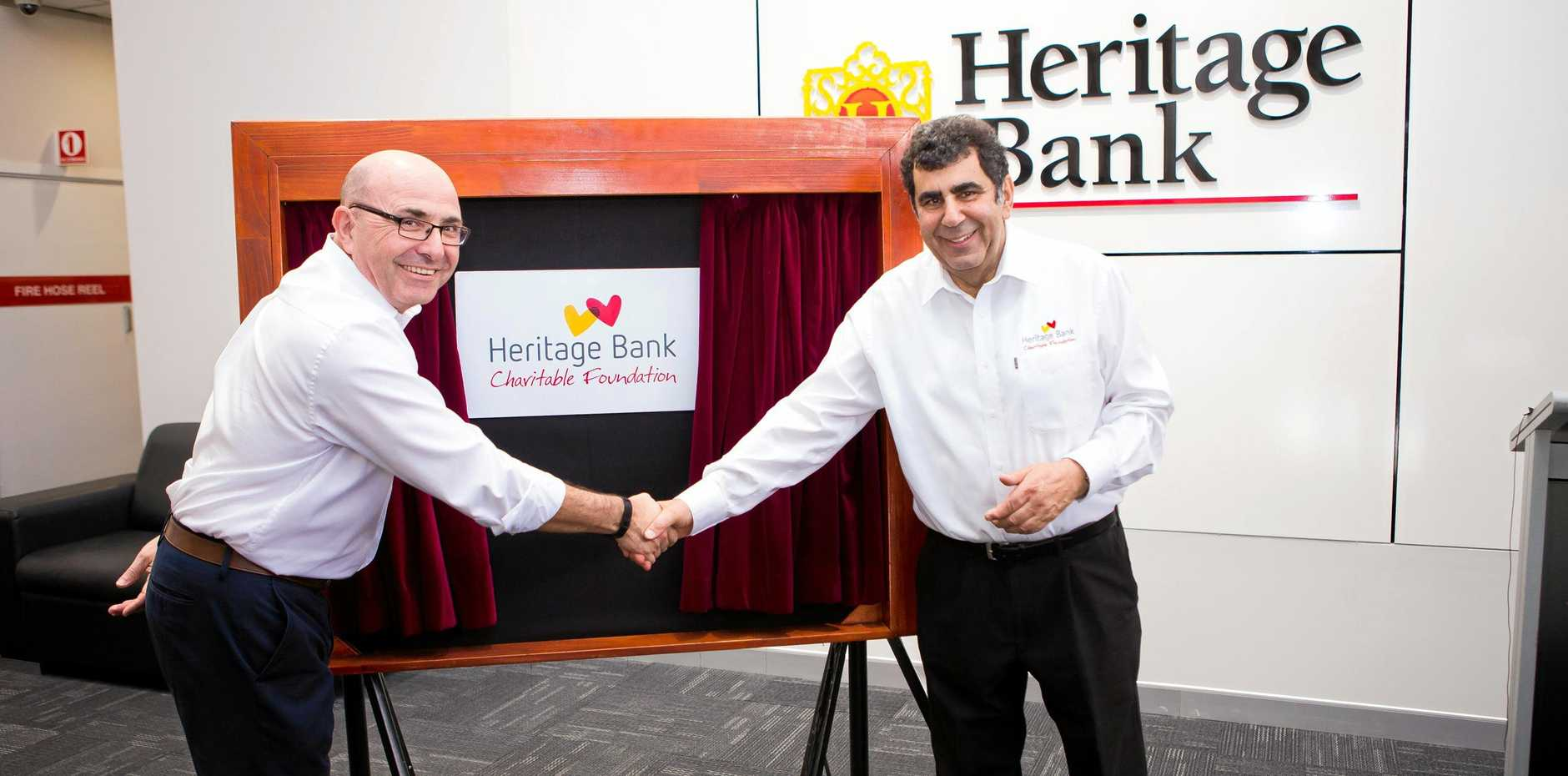 AWARD: Heritage CEO Peter Lock (left) says the bank is thrilled to be named Bank of the Year. Pictured here with chairman Kerry Betros at the launch of the new Heritage Bank Charitable Foundation.