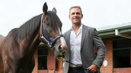 Geelong footballer Joel Selwood with All Star Mile hopeful Grunt. Picture: Pat Scala