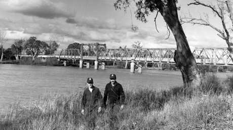 Officers searching the banks of the Murray River at Mildura.