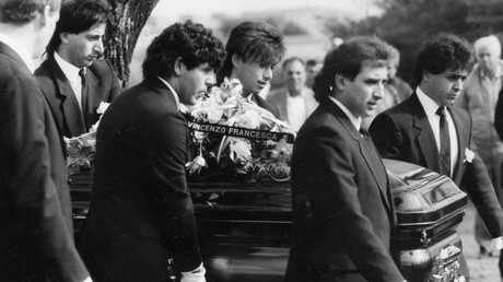 Pallbearers carry a casket at the funeral of Carmelo and Rosa Marafiote.