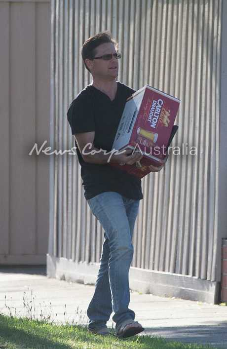 Danny Nikolic, the brother of John Nikolic, was seen carrying alcohol into the  Port Melbourne home.  Picture: Matrix for News Corp Australia