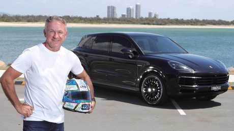 Russell Ingall with his Porsche Cayenne Hybrid at The Spit. Picture: Glenn Hampson