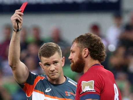 The Reds' Scott Higginbotham is sent off against the Rebels last season. Picture: AAP