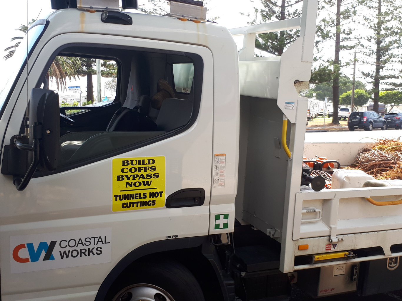 Coffs Harbour City Council's vehicle fleet has been fitted with stickers calling for tunnels on the Coffs bypass not cuttings and landbridges.