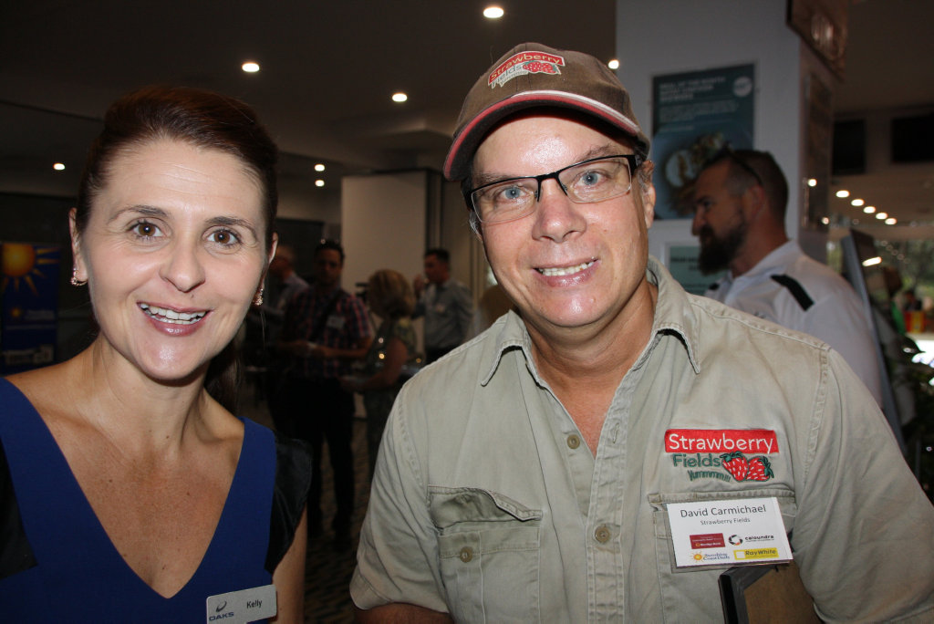 Image for sale: Kelly Edmonds of Oaks Oasis and David Carmichael of Strawberry Fields at the Caloundra Chamber of Commerce Breakfast of Champions business meeting at Dicky Beach Surf Club.