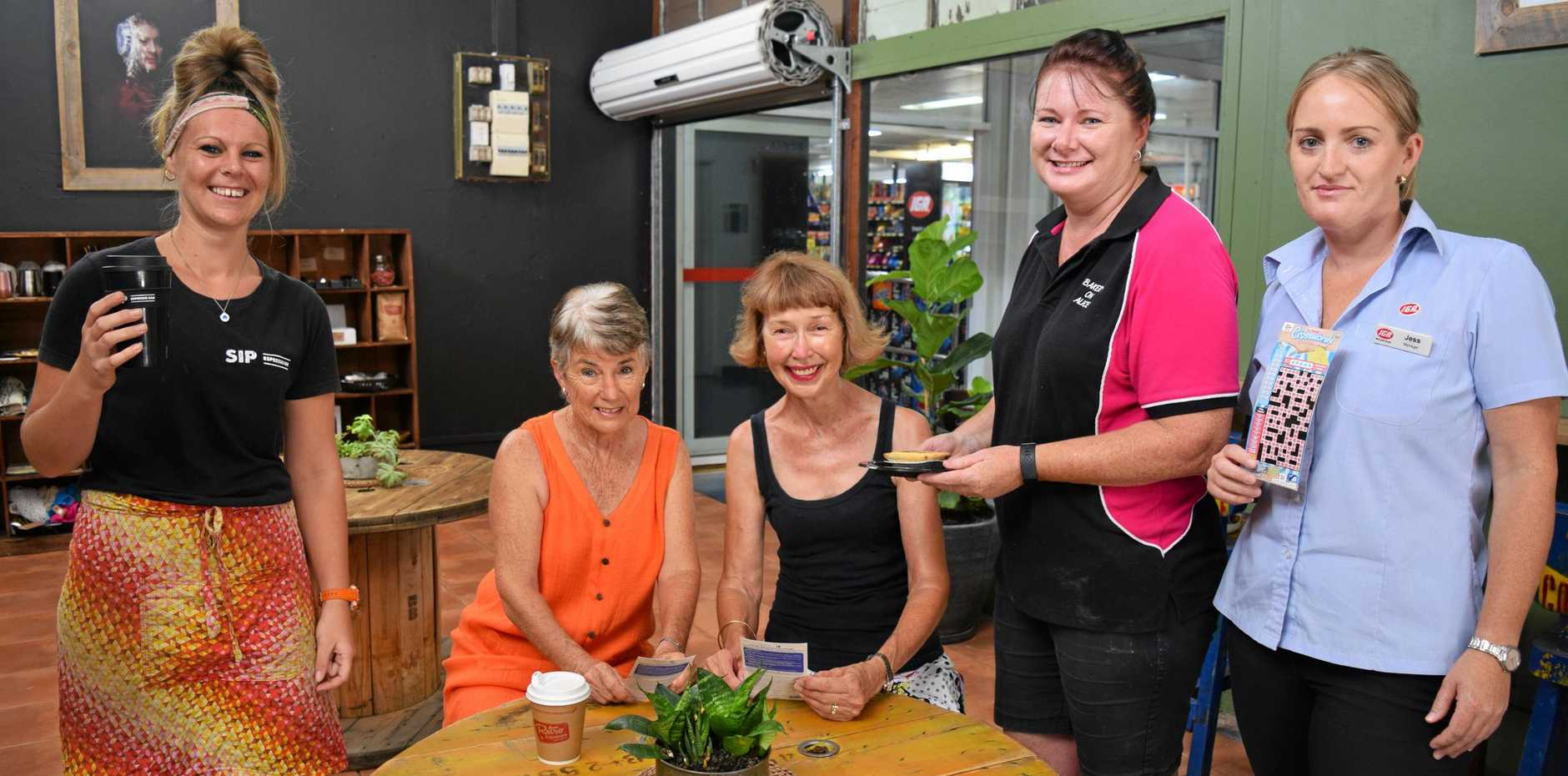 SIP customers (seated from left) Narelle Charteris and Wendy Davies can enjoy their caffeine fix from manager Amy Phillipson (left) while dining in with a bite from Bakery on Alice, Michelle Stackman, and a scratchie from IGA, Jess Hall (right).