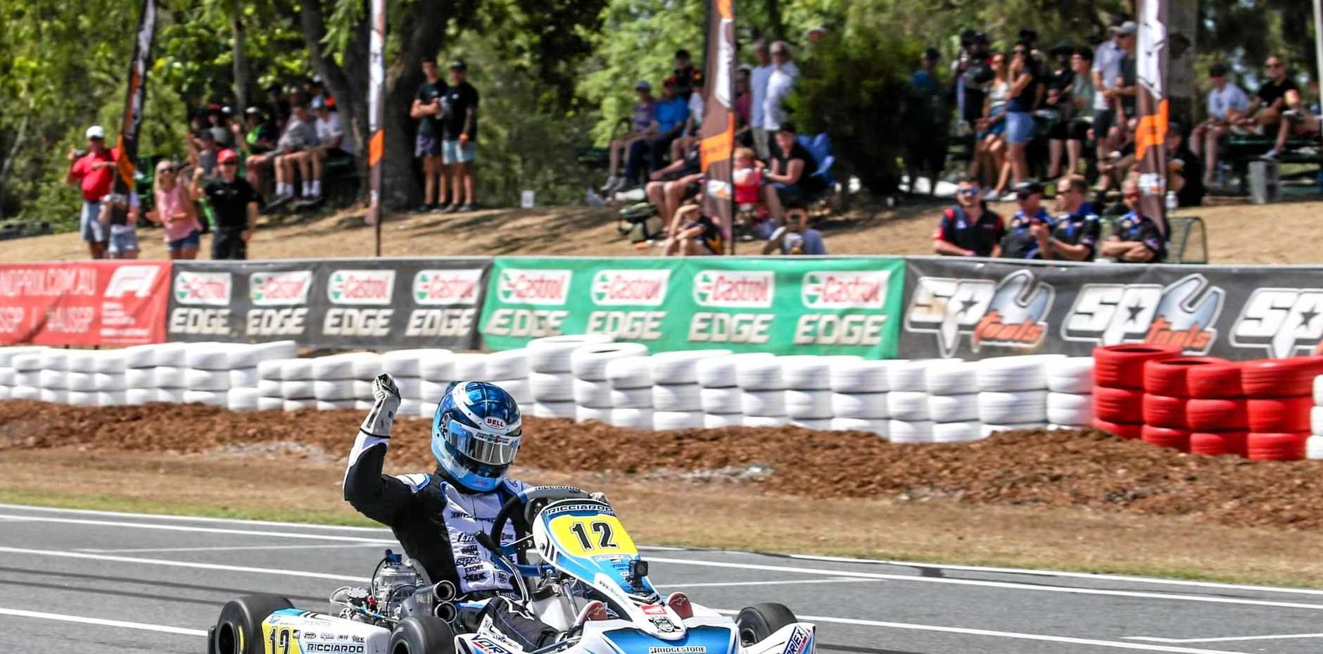 IN FRONT: Troy Loeskow celebrates winning the main race in the KZ2 class in the Australian Karting Championship.