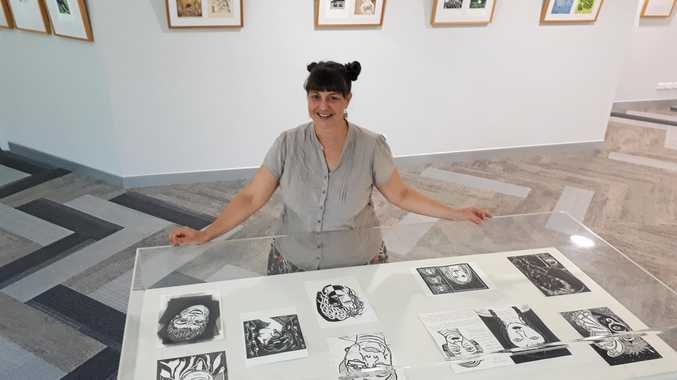 ART: Traci Lietzke of Printbank Mackay at the group's current exhibit at the Julbilee Community Centre.