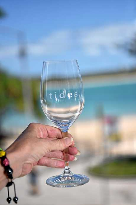 Tides wineglass with Pumicestone Passage in the background.