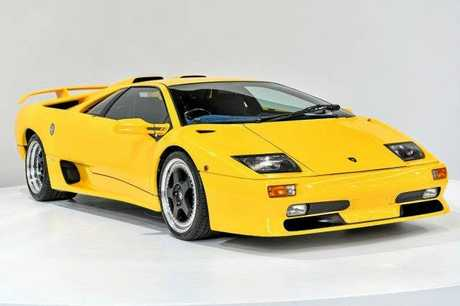 This 1999 Lamborghini Diablo SV is one of only 100 produced, making it highly collectable. In remarkable condition, this mid-engine rear drive Italian supercar in Super Fly Yellow is a guaranteed head-turner. Heightening the appeal of this car is the plush blue interior and dash, which presents in great condition.