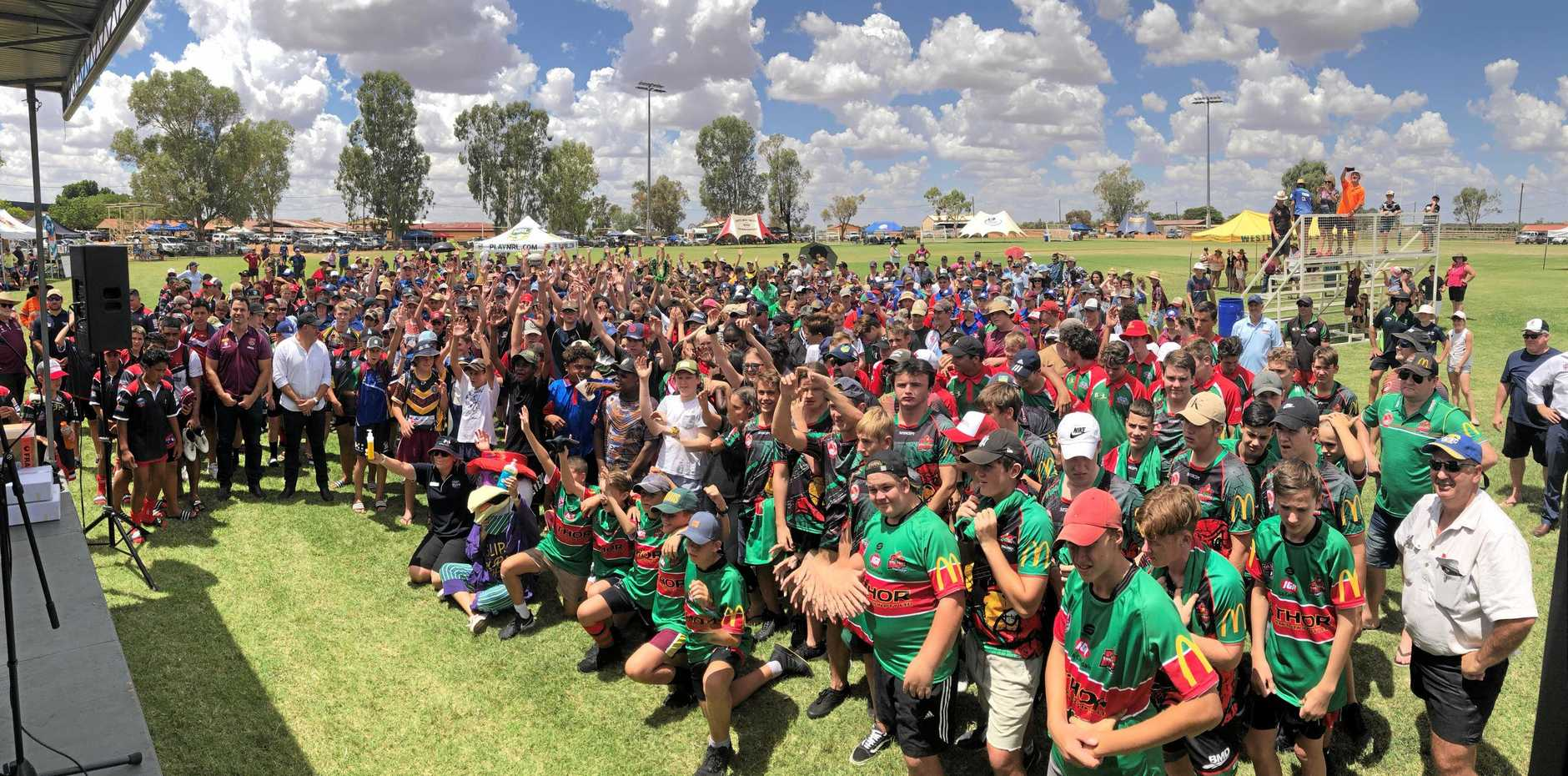 Players, coaches, parents and volunteers give a cheer for the opening of the 2019 Adrian Vowels Cup.