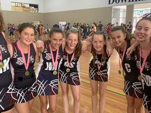 The students shooting high in annual netball competition