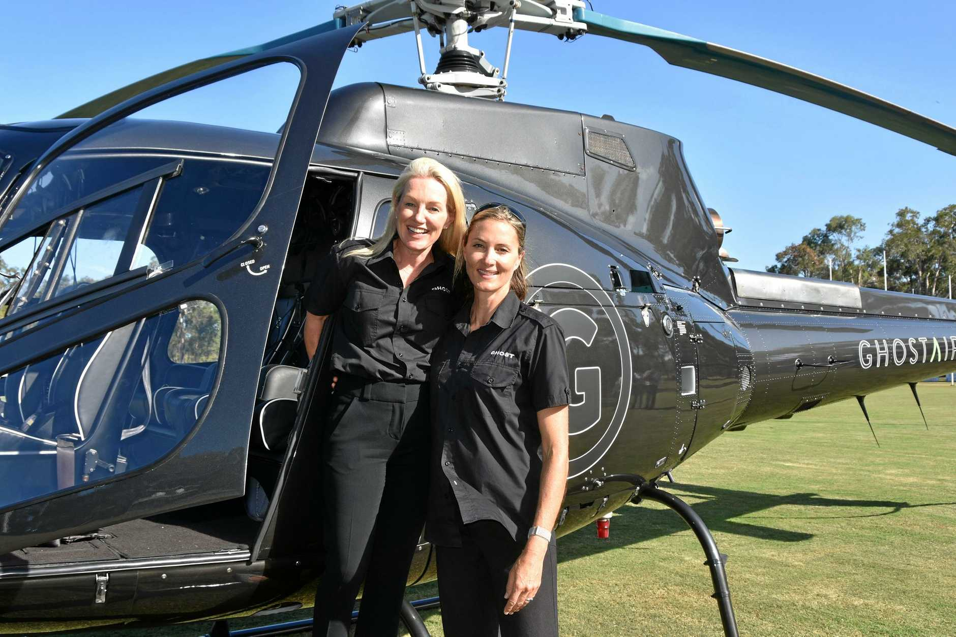 Ghost Air's operation manager Sue-Ellen Knox and head pilot Johanna Osbourne at the official launch of their new helicopter commuter service.