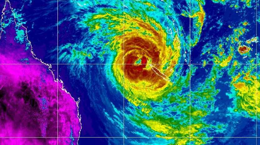 The unpredictable category 2 storm system is heading slowly towards Australia, threatening torrential rainfall, beach erosion and flooding.