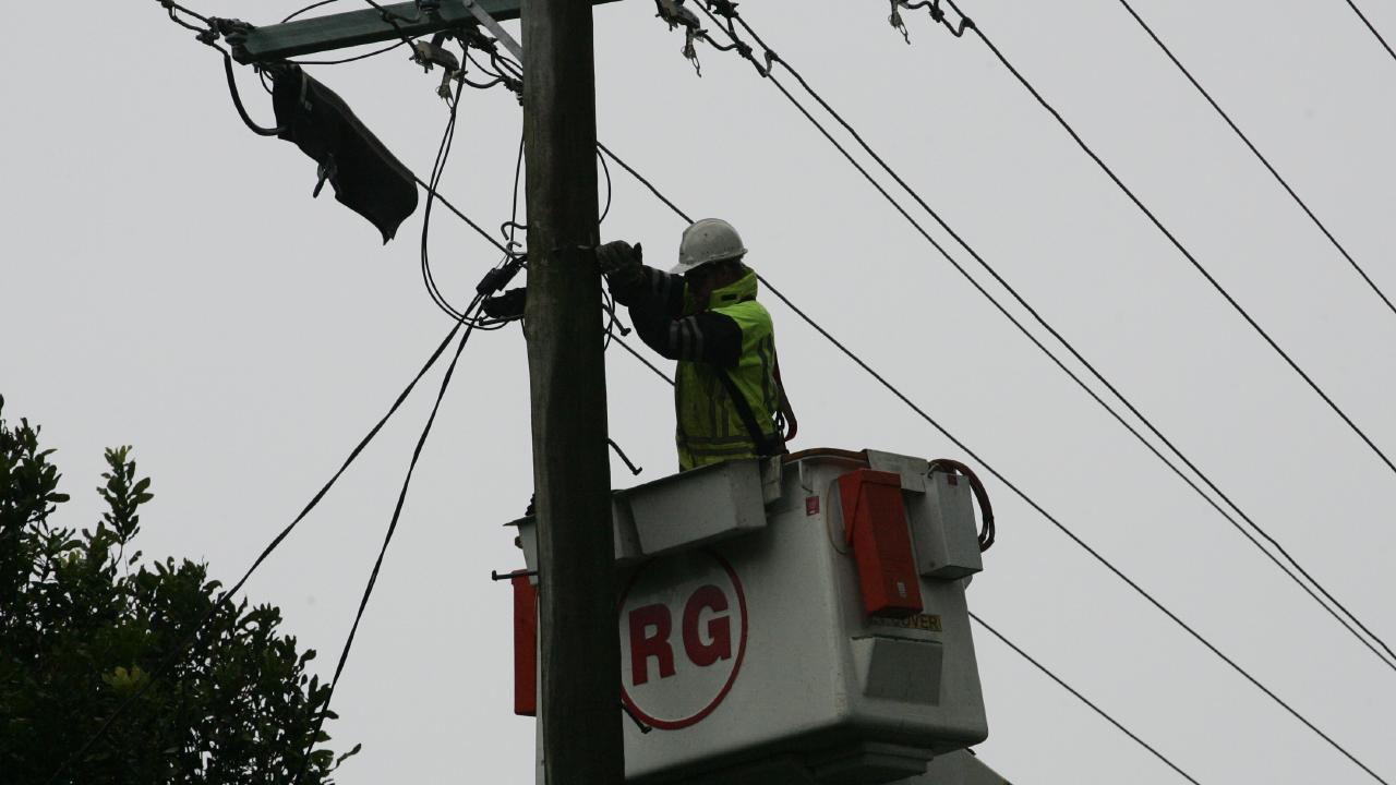 Photo is of Energex workers restoring power to Tamborine Mountain.
