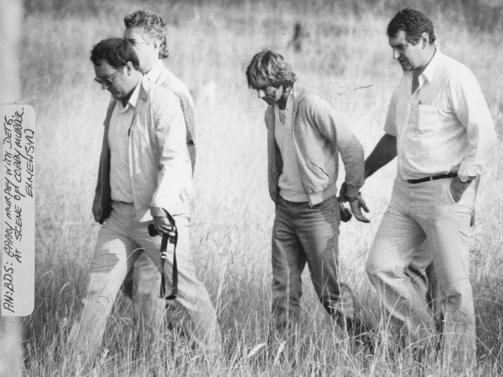 Gary Murphy with detectives in the paddock in western Sydney where the atrocities were perpetrated on nurse Anita Cobby in 1986.