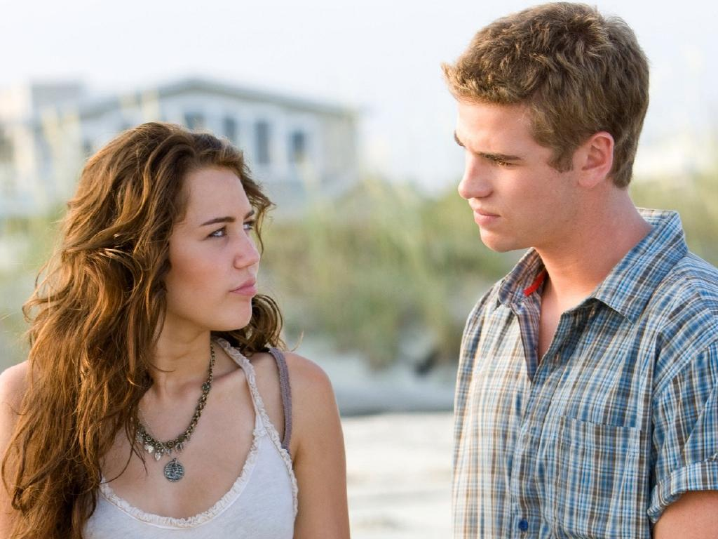 Actor Liam Hemsworth (r) and Miley Cyrus in a scene from The Last Song. Picture: AP
