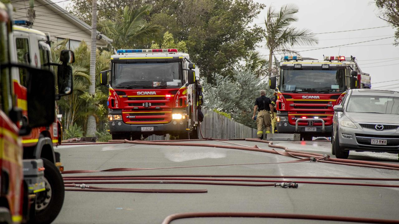 Emergency services including police and fire fighters at the scene of a house fire involving the two homes. Picture: Jerad Williams