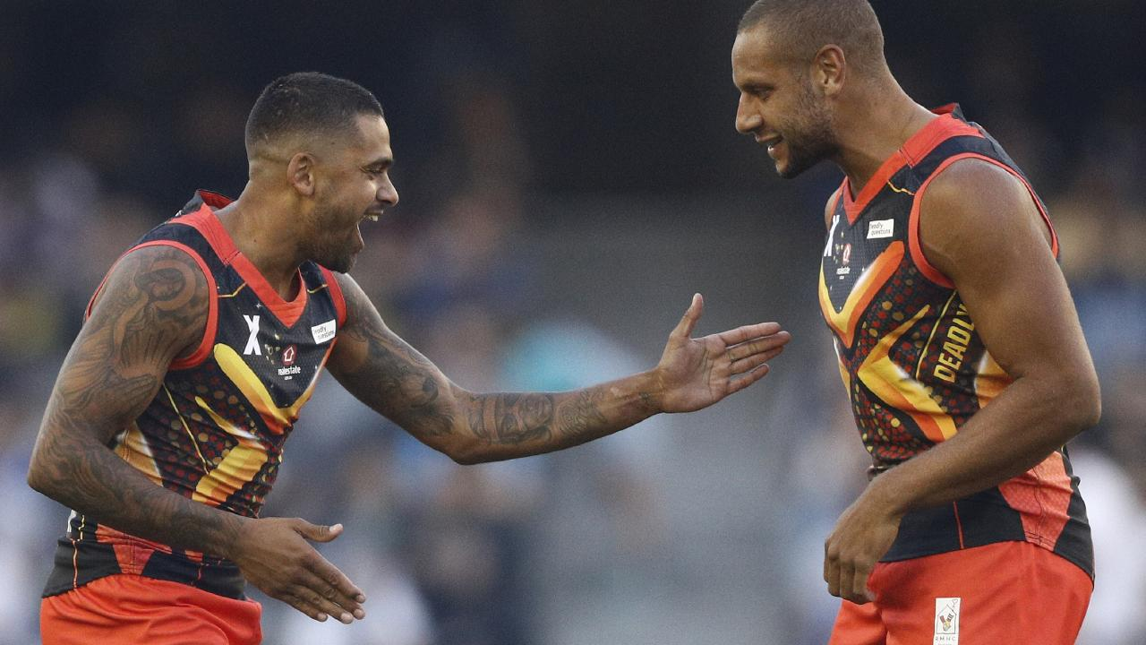Indigenous stars Tim Kelly and Cameron Ellis-Yolmen celebrate a goal. Picture: AAP
