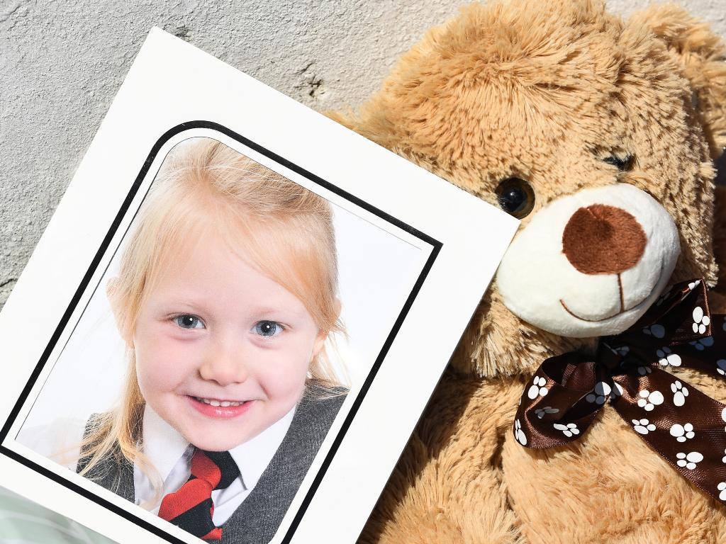 A school picture of Alesha MacPhail is left at a house on Ardbeg road in Rothesay, Isle of Bute, Scotland. Picture:Jeff J Mitchell/Getty Images