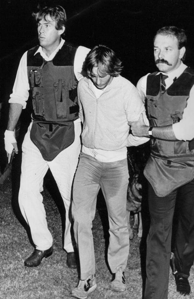Gary Murphy wets his pants as he is arrested after trying to flee his hide-out with brother Michael, the final two to be captured for killing nurse Anita Cobby in 1986.
