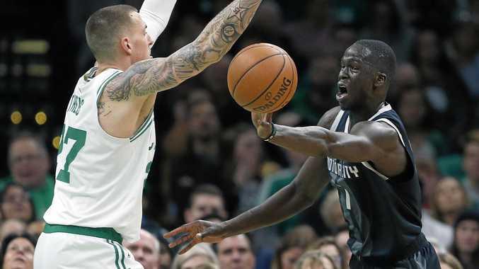 The Detroit Pistons' Thon Maker passes as the Boston Celtics' Daniel Theis does his best to disrupt the Aussie. Picture: Michael Dwyer/AP