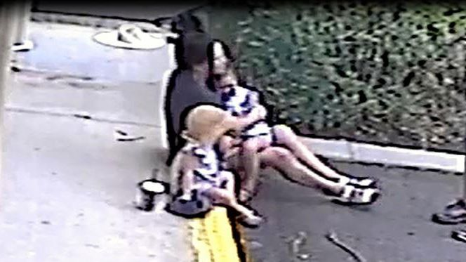 The three-year-old boy is comforted by his family after being hit by a car at a Buderim car park.