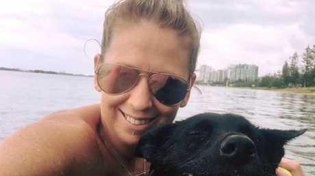 Gold Coast ED nurse Lisa Davey with her pet dog.
