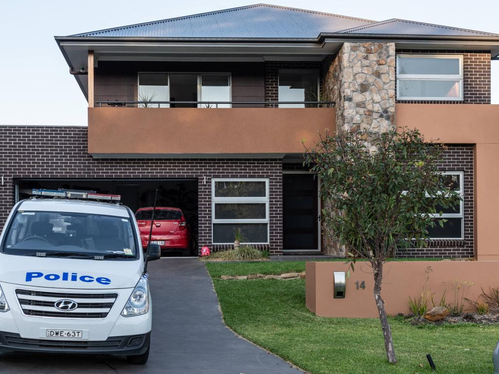 Police pictured outside Johan Schwart's home. Picture: Monique Harmer