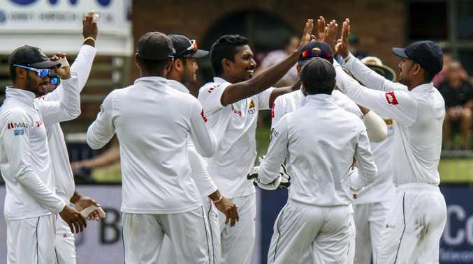 Sri Lanka's Oshada Fernando, centre, celebrates with teammates after taking a wicket during day two of the second Test at St George's Park, Port Elizabeth. Picture: Michael Sheehan/AP