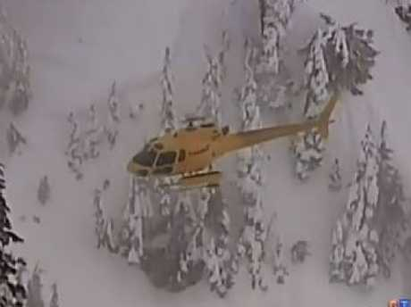 AA rescue helicopter heads to the scene of an avalanche in a closed section of mountain at Whistler where a female NSW snowboarder was killed. Picture: CTV
