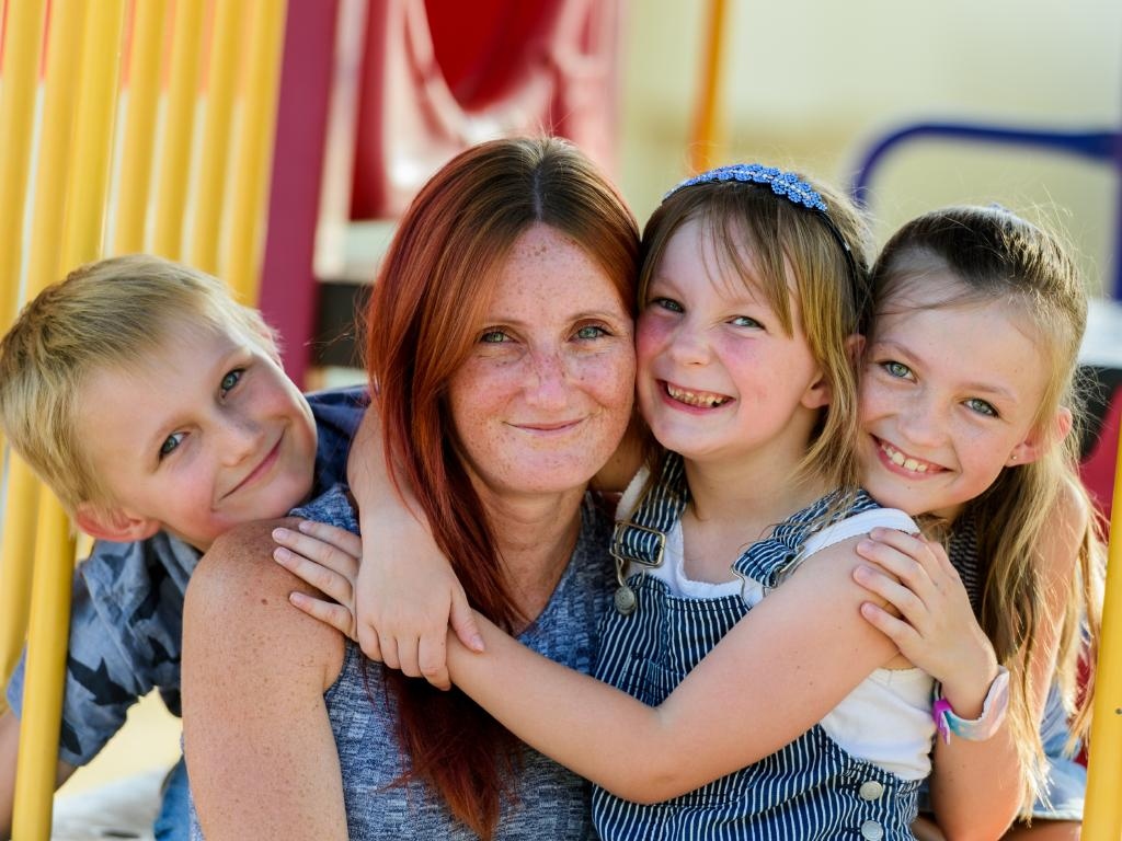 Leah Bliesner with children Slade, 7, Jazlynn, 5, and Dakota-Rose, 9, in Wandoan. Picture: Paul Beutel
