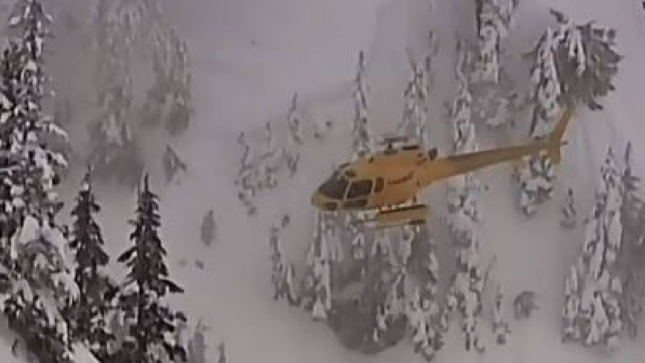 A rescue helicopter heads to the scene of an avalanche in a closed section of mountain at Whistler where a female NSW snowboarder was killed. Picture: CTV