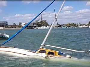 Boats run aground, sink as dangerous conditions continue