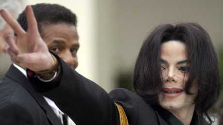 Jackson waves to his supporters during his 2005 trial. Picture: AP Photo/Michael A. Mariant, File