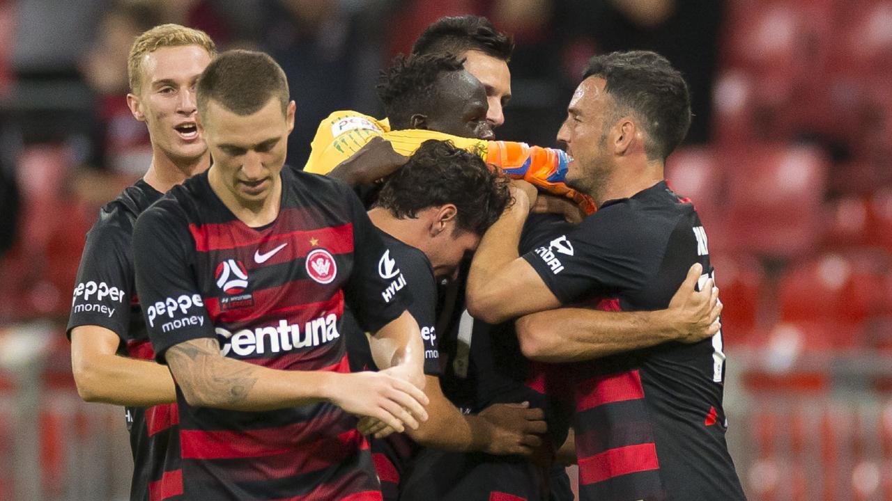 Western Sydney Wanderers celebrate Tarek Elrich's equaliser.