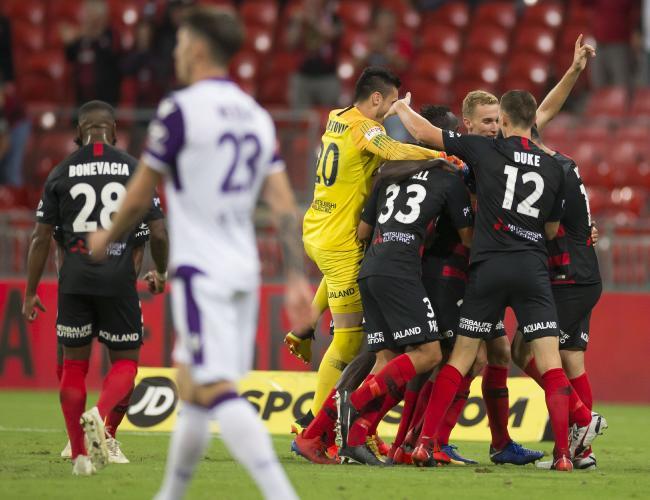 Western Sydney Wanderers celebrate Tarek Elrich's goal to seal a draw.