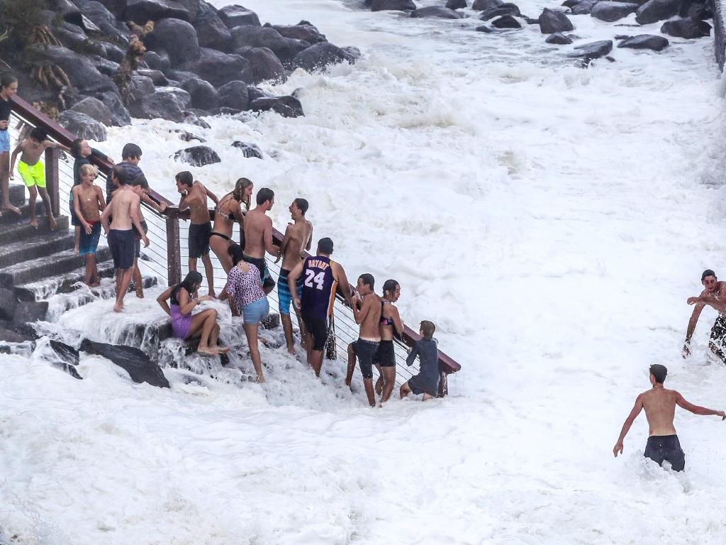 Teens flirt with danger as huge swell hits Snapper Rocks from Cyclone Oma. Picture: Nigel Hallett