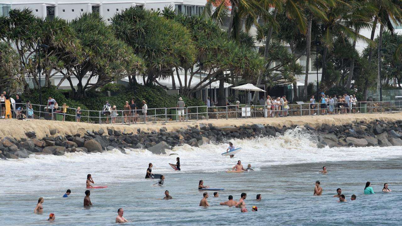 Swimmers and surfers enjoy the conditions at Noosa Main Beach, which has lost a massive amount of sand. Picture: Warren Lynam