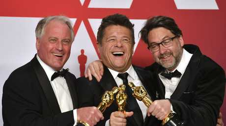 Paul Massey, from left, Tim Cavagin, and John Casali pose with the award for best sound mixing for Bohemian Rhapsody in the press room at the Oscars at the Dolby Theatre in Los Angeles.